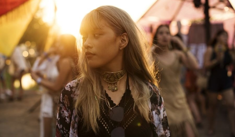 woman at a festival at sunset