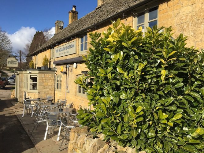 Cotswold stone pub chairs greenery