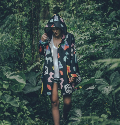 woman colourful raincoat forest