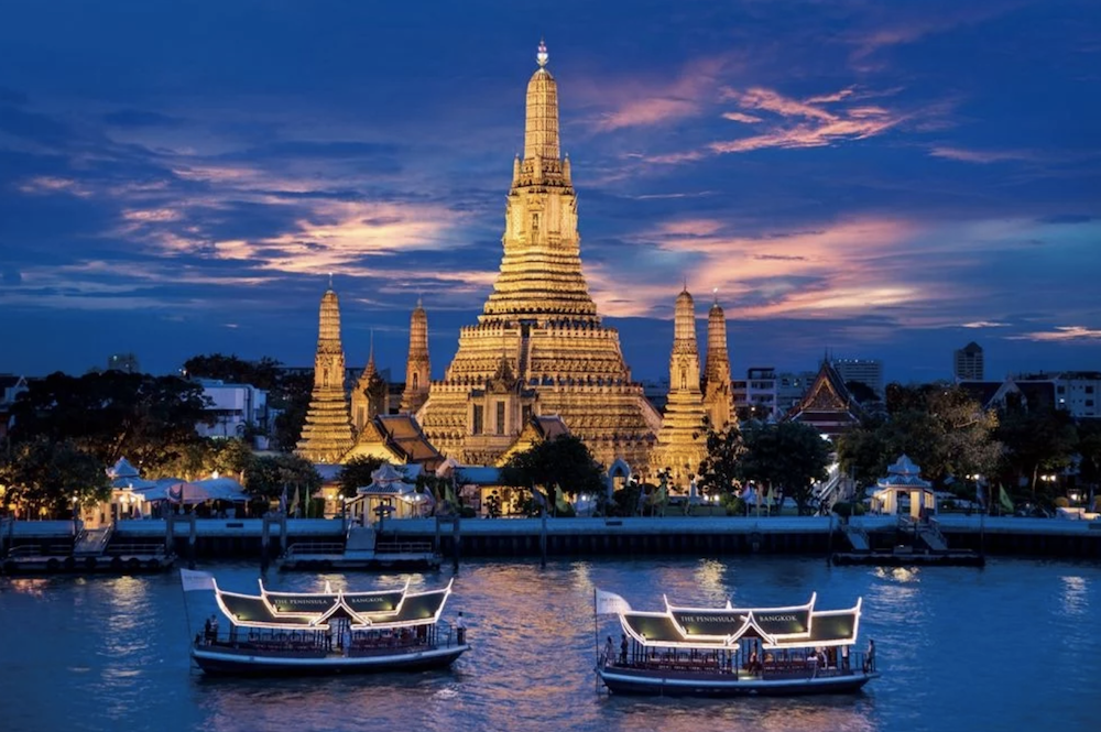 temple thailand at sunset boats