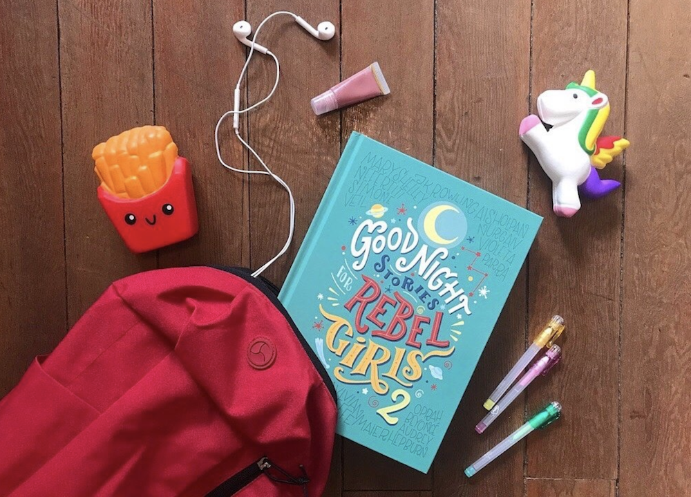 book blue cover red hat pink lip gloss unicorn headphones colouring pencils
