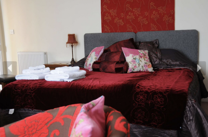 double bed red blankets cushions