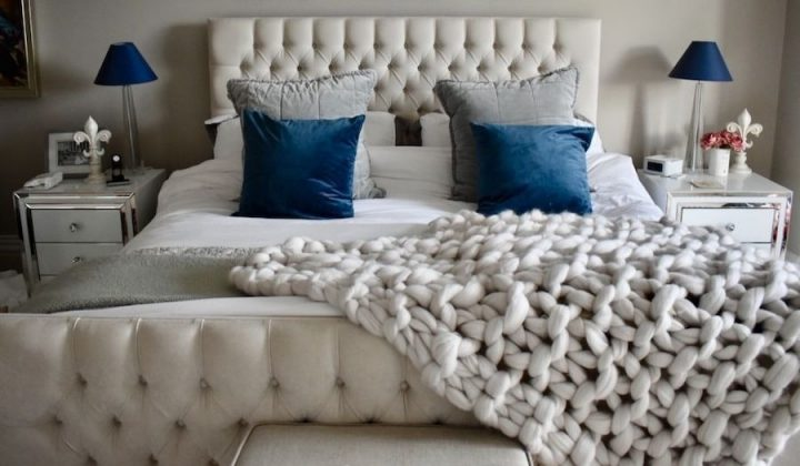 bedroom chunky knit blanket cream blue cushions