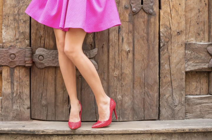 woman short pink skirt, red stilettos