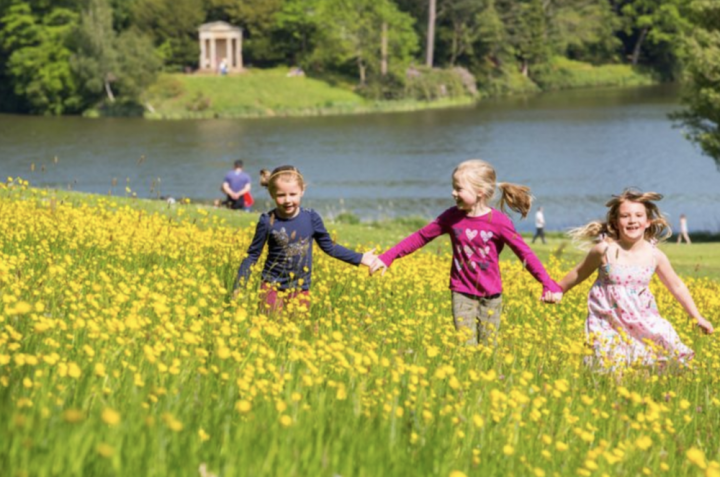 Bowood house and garden IN Calne children playing in meadow